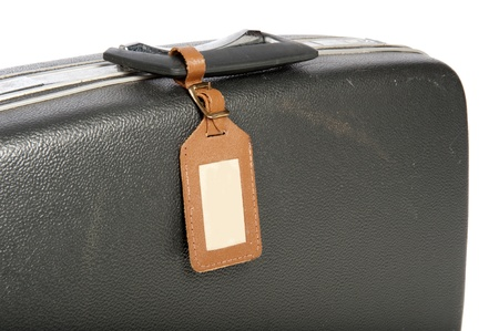 Close-up of an old suitcase isolated on white