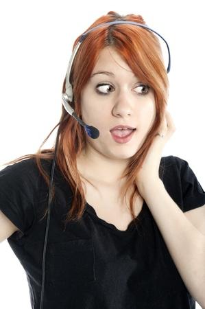 Talking receptionist talking on headset isolated on white photo