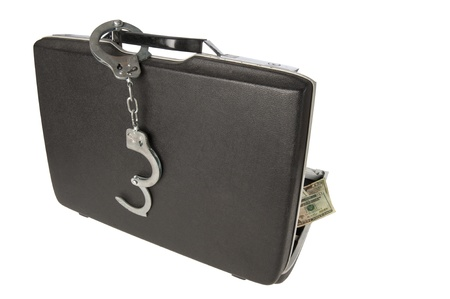 Hard-shell briefcase with stack of $20 U.S. bills visisble, handcuffs on the handle, isolated on a white background photo