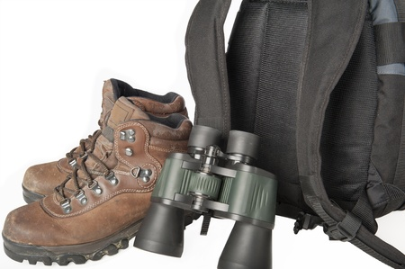Hiking gear including boots, binoculars and a backpack