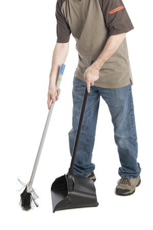 man sweeping dirt into a dustpan isolated on white background