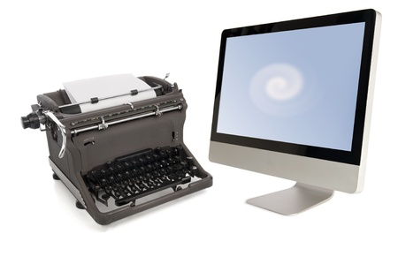 vintage manual typwriter and modern flat-panel monitor isolated on white background