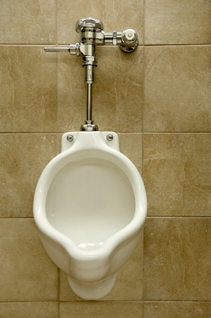 urine: urinal on a marble tiled wall in a men