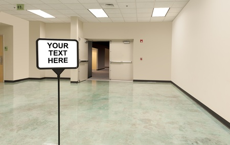 open foyer with sign preceding a doorway into an unknown area, focus on the sign Stock Photo - 10873767