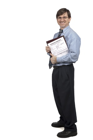 Job applicant standing with application in hand, isolated on white Stock Photo