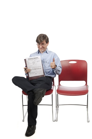 Job applicant crosses his fingers and hopes for the best, isolated on white