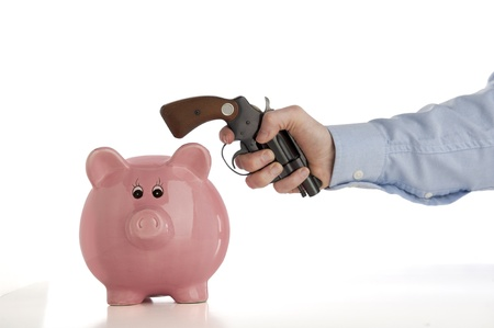 stealing money: Close-up of a piggy bank being broken up by an man swinging a gun, isolated on white