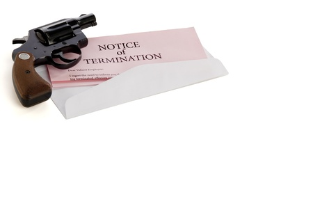 violence in the workplace: Pink slip termination notice lies on white background with a gun lying on top of it Stock Photo