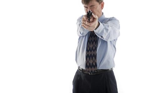 businessman aims his gun, isolated on white, selective focus on gun photo