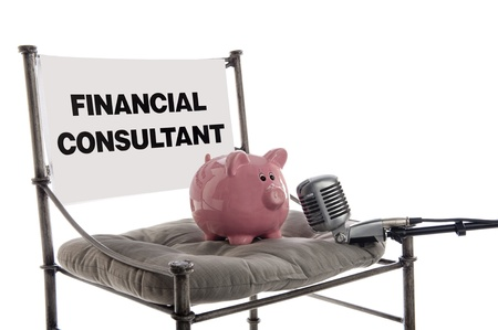 Piggy bank sits in the guest chair as a financial consultant with a microphone, isolated on white photo