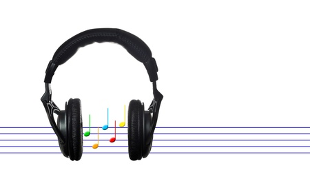 Black headphones with musical score on white
