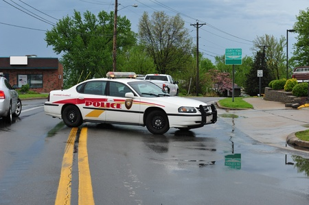 roadblock: police cars block off a road Editorial