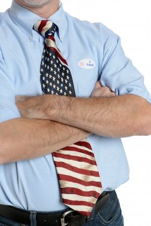 voted: Patriotic voter wearing a U S  flag tie and dress shirt sports an  I voted  sticker