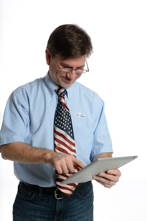Patriotic voter wearing a U S  flag tie and dress shirt sports an  I voted  sticker Stock Photo - 16191903
