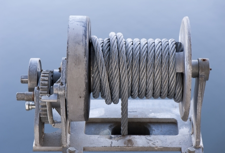 boat winch with steel cable for lifting boats at a dock, focus on the wound cable Stock Photo - 16947369