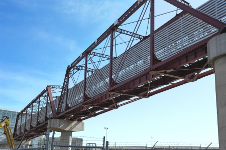 Pedestrian bridge made from an old train bridge rises into the sky Stock Photo - 20017406