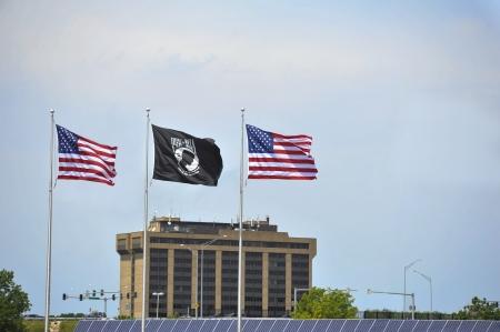 pow: two United States and one POW MIA flag