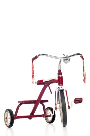 Red child's tricycle on a white Stock Photo - 23312042