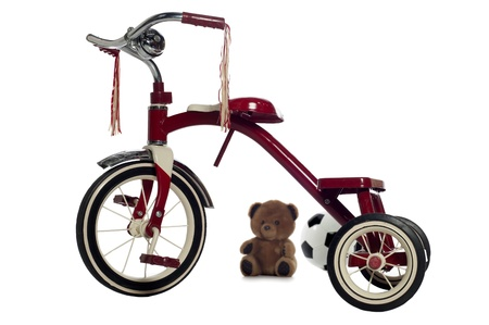 Red child's tricycle on a white Stock Photo - 23312065