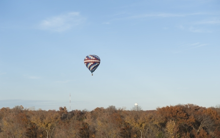 hot air balloon over woods Stock Photo - 23870915