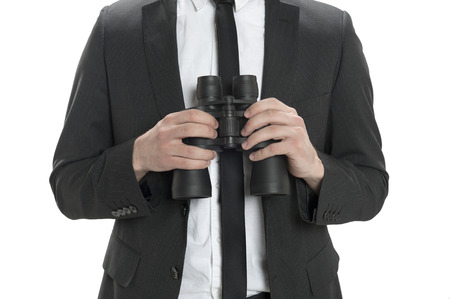Closeup of a man holding binoculars isolated on white photo