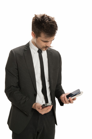 Young business man examines several cell phones