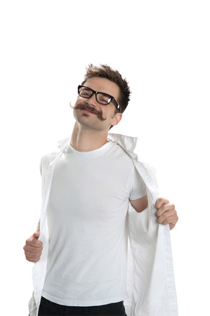 Young confident man gets undressed Stock Photo