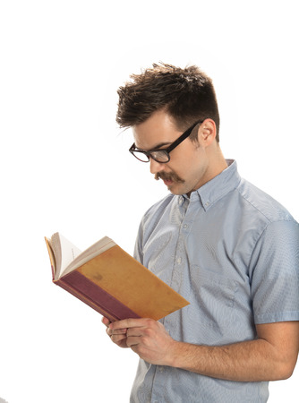 Attractive young man reading an old book, isolated on white background photo