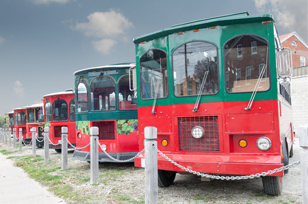 A row of colorful buses ready for wine season tourists in rural Missouri, United States