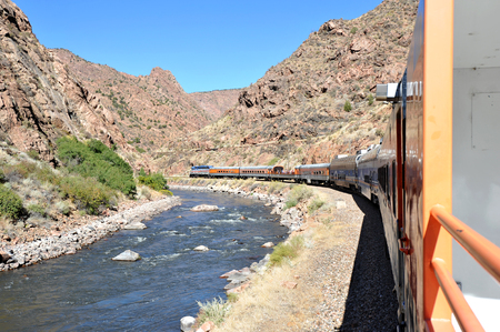 Passenger Train and white water river flowing through Colorados Royal Gorge Stock Photo