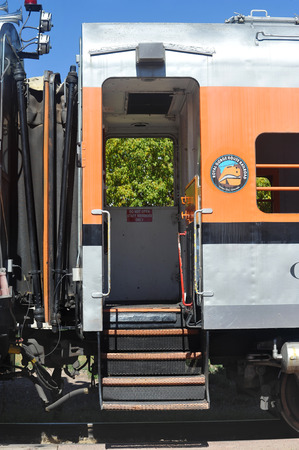 An open door welcomes visitors to a train car