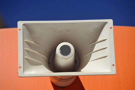 Outdoor Public Address Speaker Mounted to the top of a Railroad Train Car Stock Photo