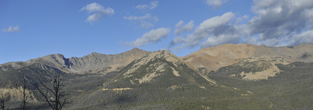 A wide panoramic view of the Rocky Mountains at dawn. Stock Photo