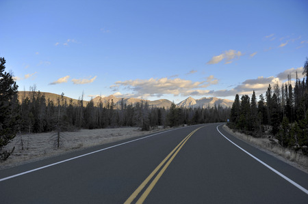 A road leading to Mount Ida in Colorado at dawn reveals the mountains ahead