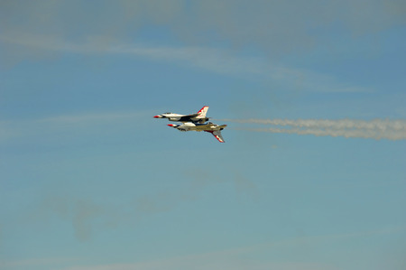 Thunderbird jets perform precision maneuvers in an air show. Editorial