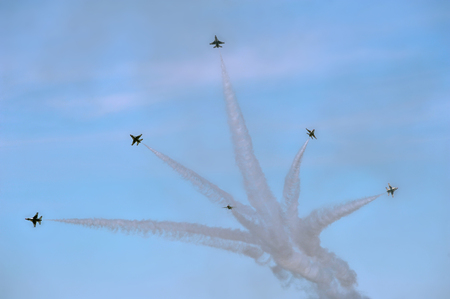 Thunderbird jets perform precision maneuvers in an air show. Stock Photo