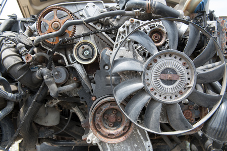 View of an engine with multiple parts missing giving a good view of the timing belt, gears, and other components Stock Photo