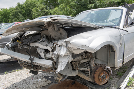 Front end of a wrecked car in a salvage yard, the wheels removed Standard-Bild - 105788910