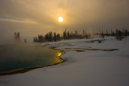 Sunrise at a Yellowstone National Park mineral pool in Winter Stock Photo