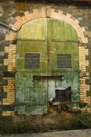 A colorful, old, worn, door in a wall