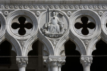 justice sculpture on building in Venice, Italy Stock Photo