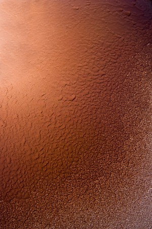 Abstract background of melting frost on orange steel