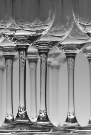 Wine glasses stacked on a shelf in Black and white