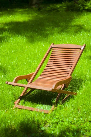 Chaise longue on the grass photo