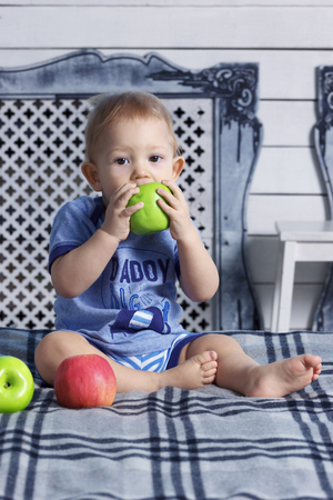 paraffin: Little baby boy in parents bedroom with paraffin wax apples Stock Photo