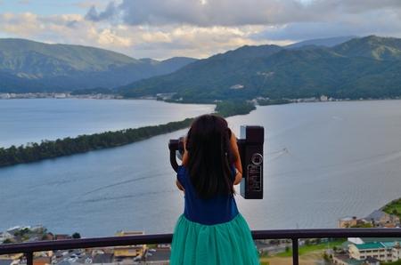 amano: Girl seen through a telescope Stock Photo