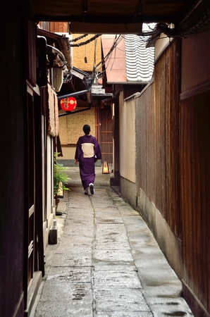 tenement buildings: Japan women in kimono walking Street Stock Photo