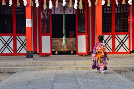 Girl in kimono to pray