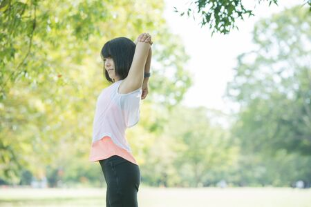 a woman exercising in the park
