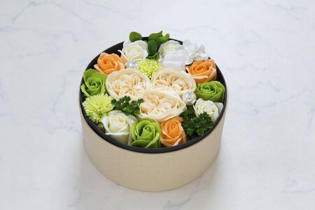 a bouquet in a round box